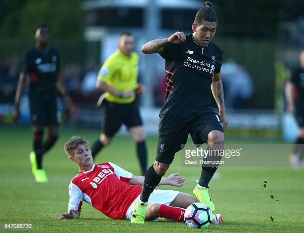 Roberto Firmino of Liverpool gets past Nick Haughton of Fleetwood Town during the PreSeason Friendly match between Fleetwood Town and Liverpool at...