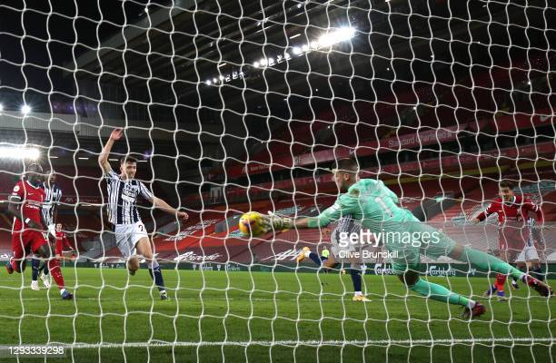 Roberto Firmino of Liverpool has a headed shot that is saved by Sam Johnstone of West Bromwich Albion during the Premier League match between...