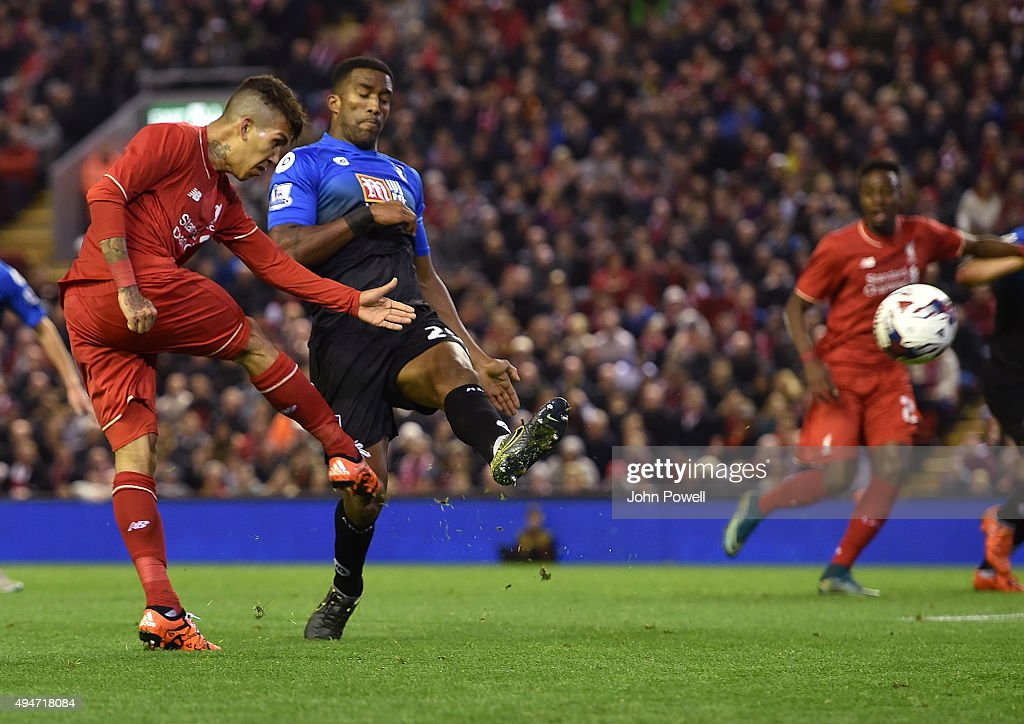 Roberto Firmino of Liverpool has a shot during the Capital One Cup Fourth Round match between Liverpool and AFC Bournemouth at Anfield on October 28, 2015 in Liverpool, England.