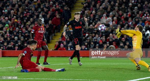 Roberto Firmino of Liverpool has a shot saved by Jan Oblak of Atletico Madrid during the UEFA Champions League round of 16 second leg match between...