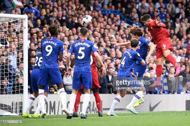 Roberto Firmino of Liverpool heads home his teams second goal during the Premier League match between Chelsea FC and Liverpool FC at Stamford Bridge...