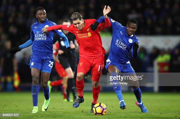 Roberto Firmino of Liverpool holds off Daniel Amartey of Leicester City and Wilfred Ndidi of Liecester City during the Premier League match between...