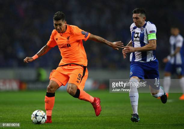 Roberto Firmino of Liverpool holds off Hector Herrera of FC Porto during the UEFA Champions League Round of 16 First Leg match between FC Porto and...