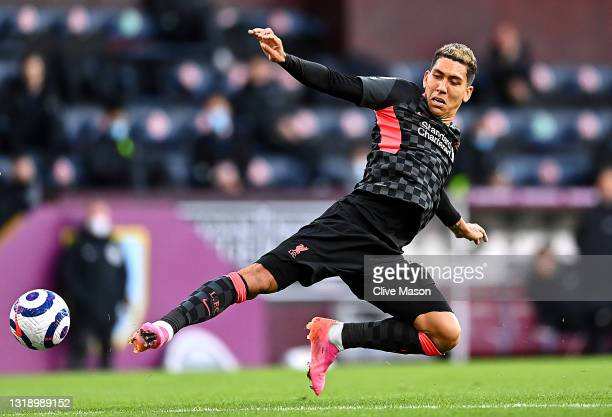 Roberto Firmino of Liverpool in action during the Premier League match between Burnley and Liverpool at Turf Moor on May 19, 2021 in Burnley, England.