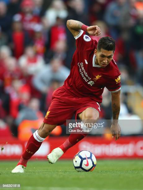 Roberto Firmino of Liverpool in action during the Premier League match between Liverpool and AFC Bournemouth at Anfield on April 14 2018 in Liverpool...