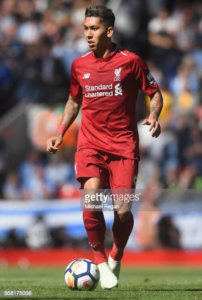 Roberto Firmino of Liverpool in action during the Premier League match between Liverpool and Brighton and Hove Albion at Anfield on May 13 2018 in...