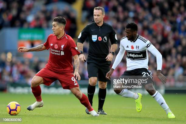 Roberto Firmino of Liverpool in action with AndreFrank Zambo Anguissa of Fulham during the Premier League match between Liverpool FC and Fulham FC at...