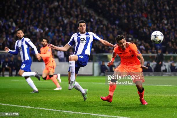 Roberto Firmino of Liverpool in action with Ivan Marcano of FC Porto tries to block during the UEFA Champions League Round of 16 First Leg match...