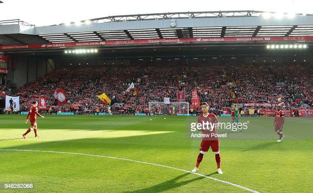 Roberto Firmino of Liverpool in front of the Kop stand before the Premier League match between Liverpool and AFC Bournemouth at Anfield on April 14...