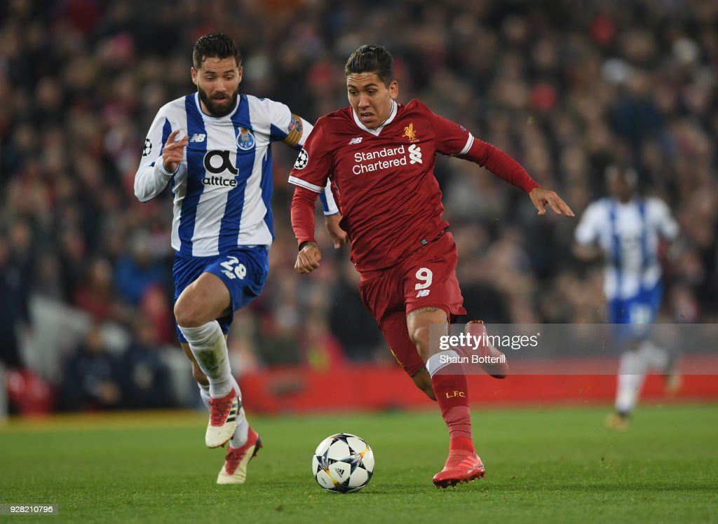 Roberto Firmino of Liverpool is challenged by Felipe of FC Porto during the UEFA Champions League Round of 16 second leg match between Liverpool and FC Porto at Anfield on March 6, 2018 in Liverpool, United Kingdom.