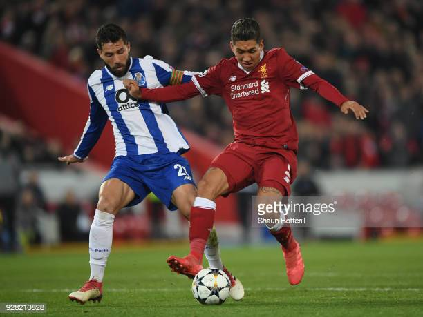 Roberto Firmino of Liverpool is challenged by Felipe of FC Porto during the UEFA Champions League Round of 16 second leg match between Liverpool and...