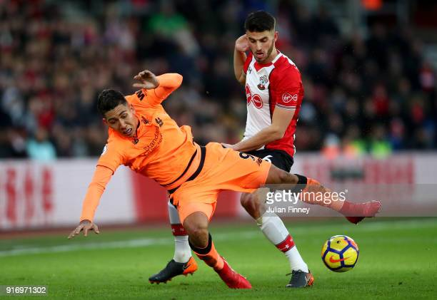 Roberto Firmino of Liverpool is challenged by Wesley Hoedt of Southampton during the Premier League match between Southampton and Liverpool at St...