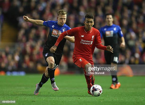 Roberto Firmino of Liverpool is closed down by Matt Ritchie of Bournemouth during the Capital One Cup Fourth Round match between Liverpool and AFC...
