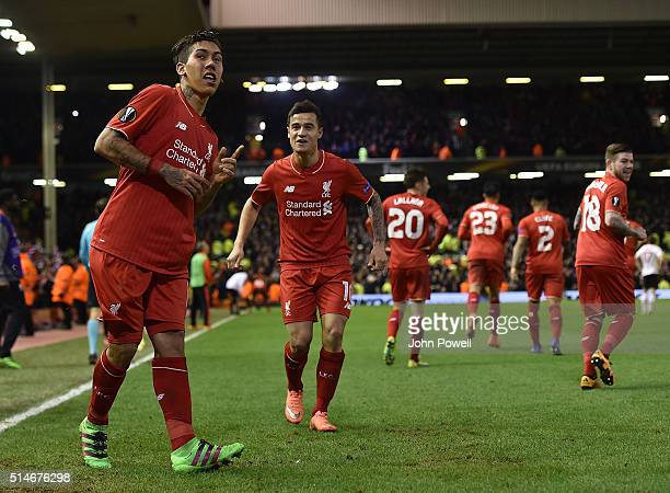 Roberto Firmino of Liverpool is congratulated after his goal during the UEFA Europa League Round of 16 first leg match between Liverpool and...