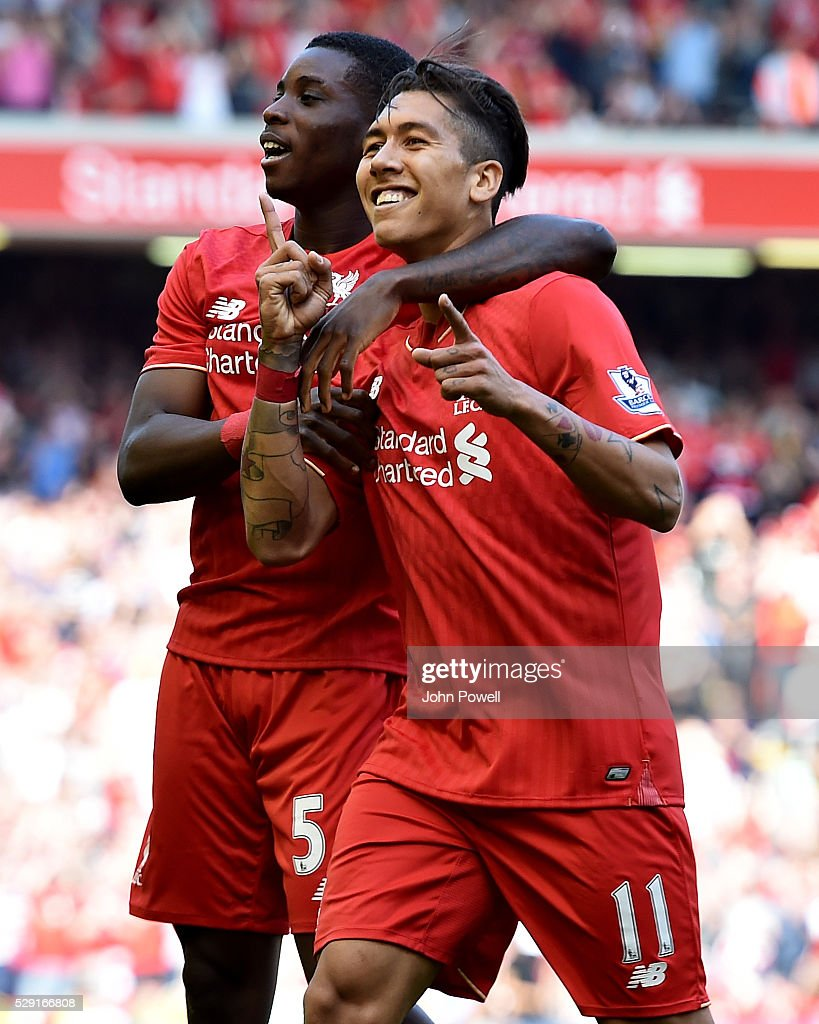 Roberto Firmino of Liverpool is congratulated by Sheyi Ojo of Liverpool after his goal during the Barclays Premier League match between Liverpool and Watford at Anfield on May 08, 2016 in Liverpool, England.