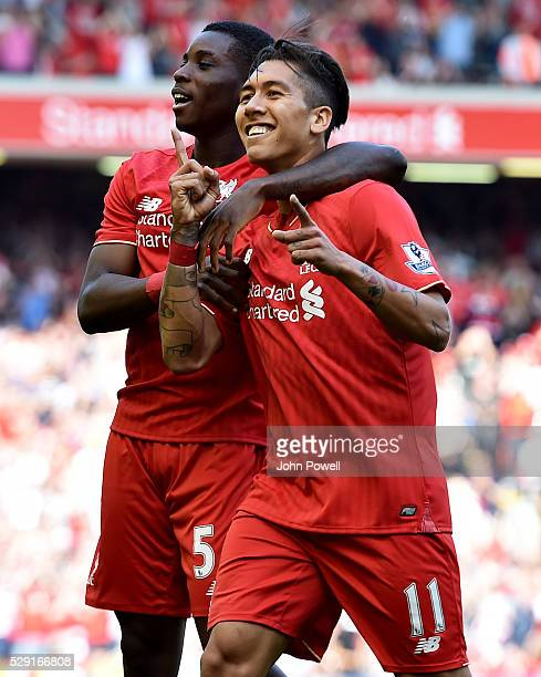 Roberto Firmino of Liverpool is congratulated by Sheyi Ojo of Liverpool after his goal during the Barclays Premier League match between Liverpool and...