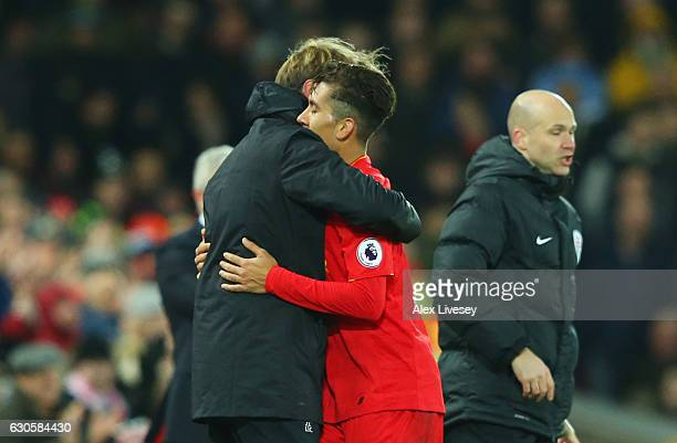 Roberto Firmino of Liverpool is embraced by Jurgen Klopp manager of Liverpool as he is substituted during the Premier League match between Liverpool...