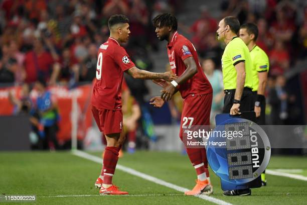 Roberto Firmino of Liverpool is replaced as a substitute by teammate Divock Origi during the UEFA Champions League Final between Tottenham Hotspur...