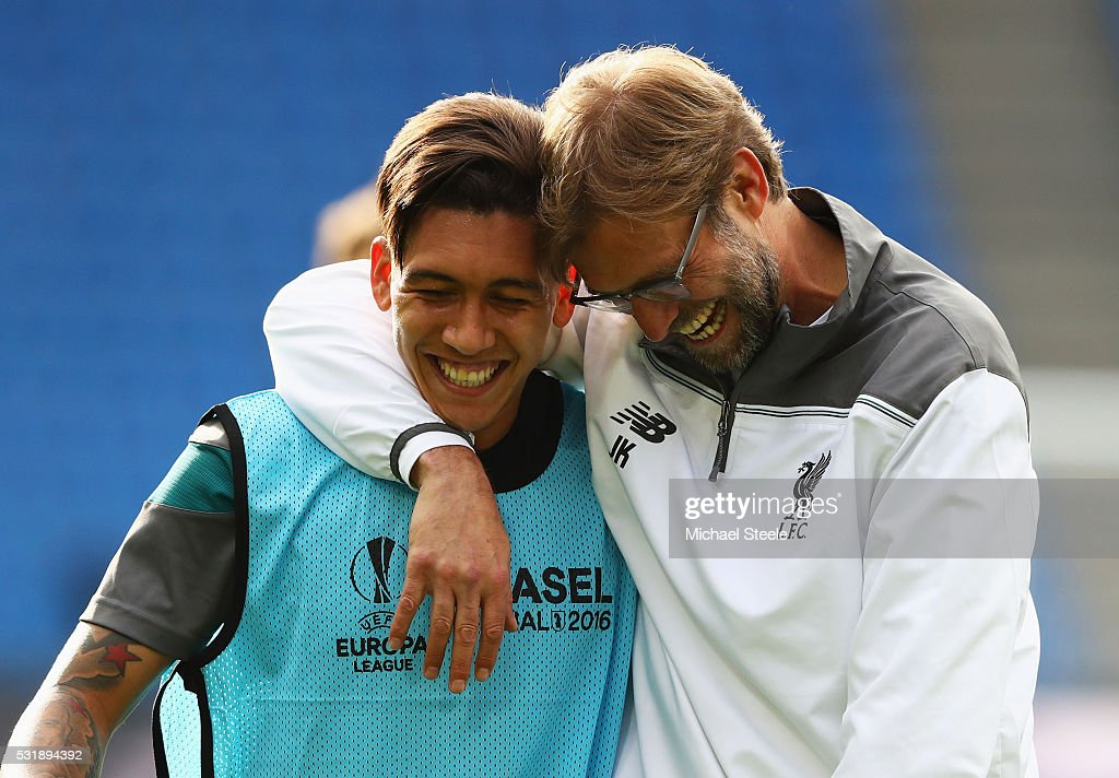 Roberto Firmino of Liverpool laughs with manager Jurgen Klopp during a Liverpool training session on the eve of the UEFA Europa League Final against Sevilla at St. Jakob-Park on May 17, 2016 in Basel, Switzerland.