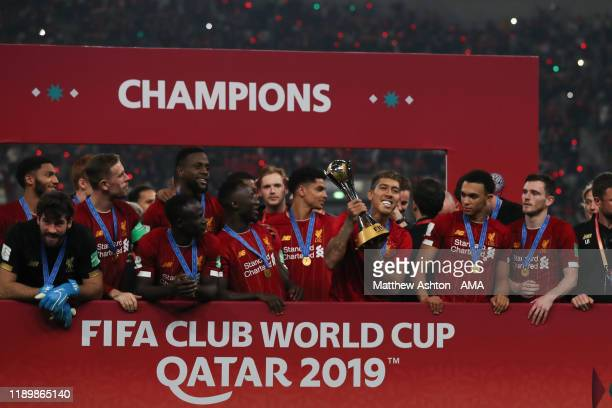 Roberto Firmino of Liverpool lifts and celebrates with the FIFA Club World Cup Trophy during the FIFA Club World Cup Qatar 2019 Final match between...