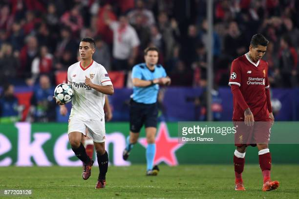 Roberto Firmino of Liverpool looks dejected after Wissam Ben Yedder of Sevilla just scored his sides second goal during the UEFA Champions League...