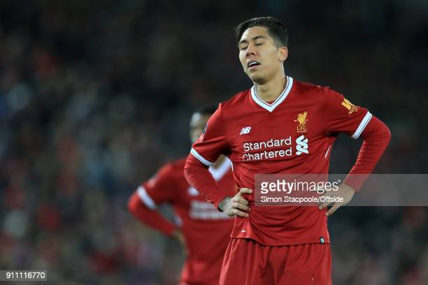 Roberto Firmino of Liverpool looks dejected during The Emirates FA Cup Fourth Round match between Liverpool and West Bromwich Albion at Anfield on...