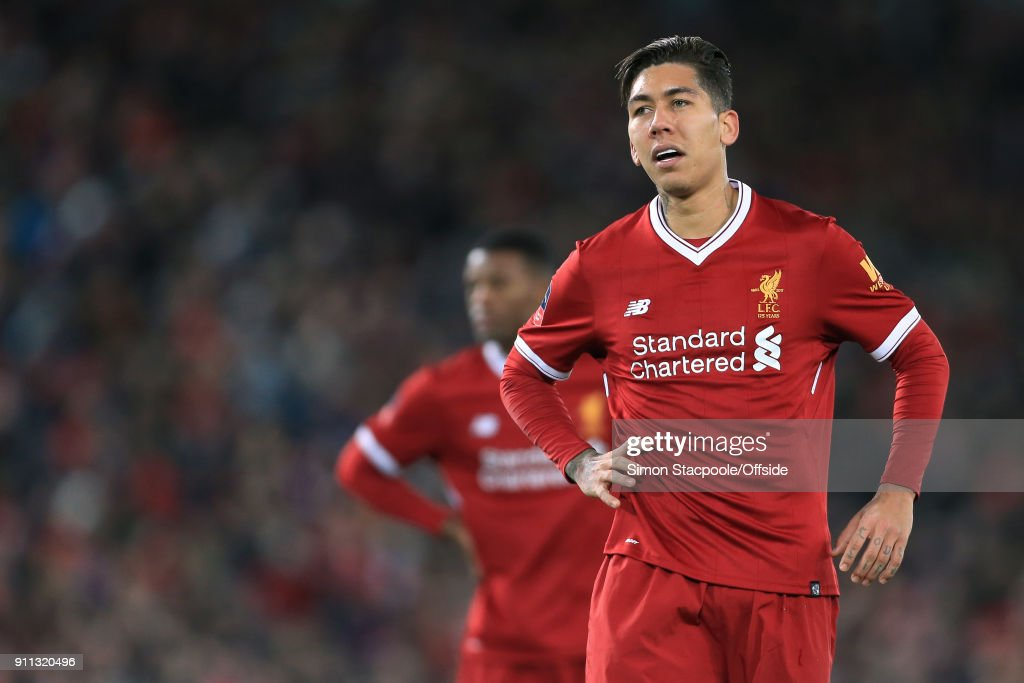 Roberto Firmino of Liverpool looks dejected during The Emirates FA Cup Fourth Round match between Liverpool and West Bromwich Albion at Anfield on January 27, 2018 in Liverpool, England.