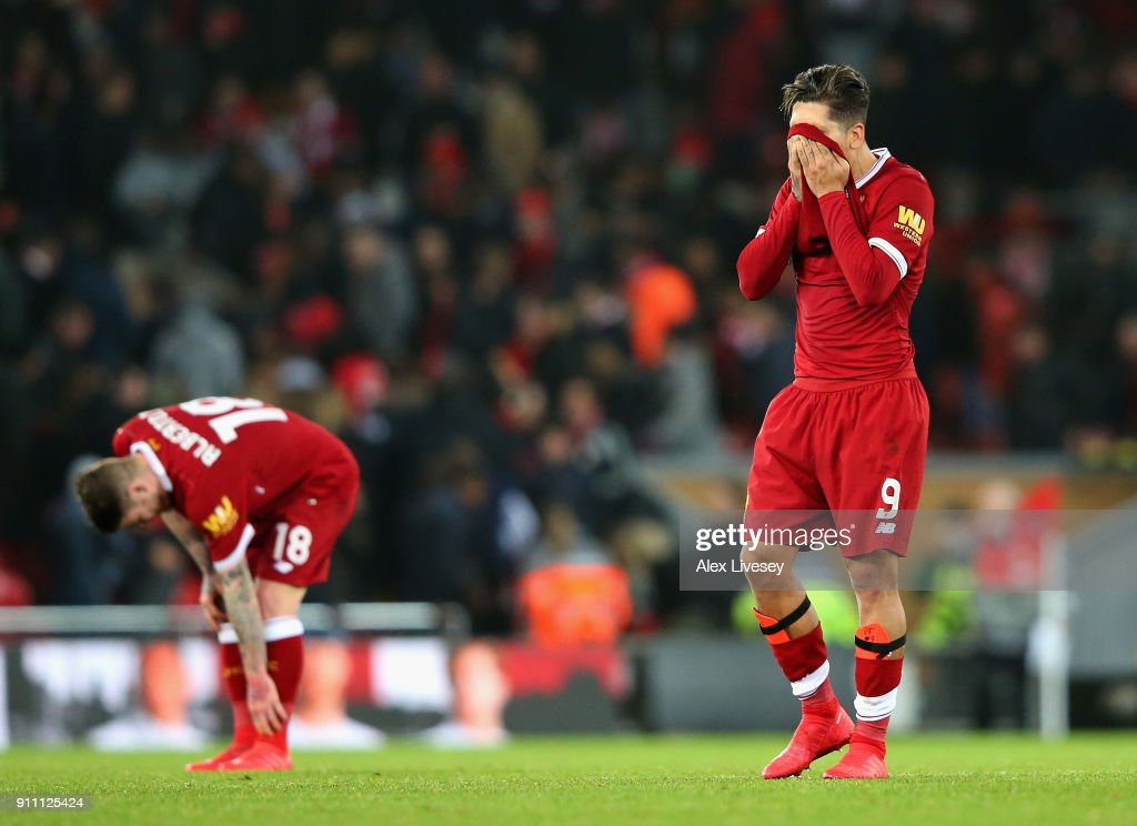 Roberto Firmino of Liverpool looks dejected following defeat during The Emirates FA Cup Fourth Round match between Liverpool and West Bromwich Albion at Anfield on January 27, 2018 in Liverpool, England.