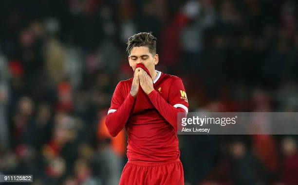 Roberto Firmino of Liverpool looks dejected following defeat during The Emirates FA Cup Fourth Round match between Liverpool and West Bromwich Albion...