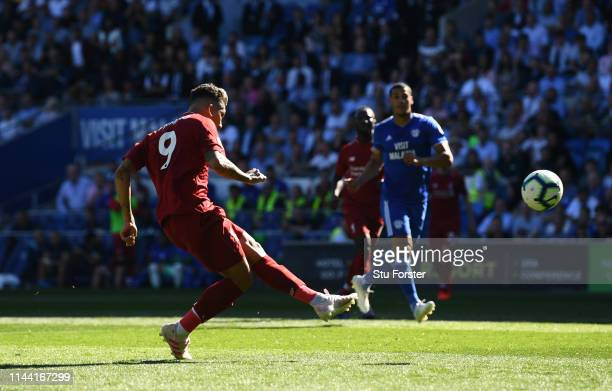 Roberto Firmino of Liverpool misses a chance during the Premier League match between Cardiff City and Liverpool FC at Cardiff City Stadium on April...