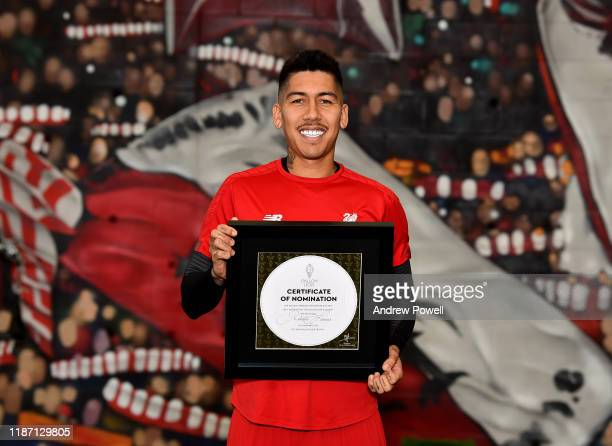 Roberto Firmino of Liverpool pose for a picture with his Ballon D'or Nominations at Melwood Training Ground on November 12, 2019 in Liverpool,...