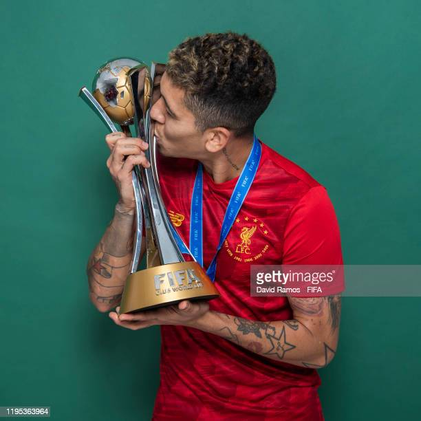 Roberto Firmino of Liverpool poses with the Club World Cup trophy after the FIFA Club World Cup Qatar 2019 Final match between Liverpool and CR...