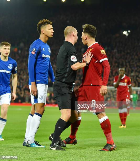 Roberto Firmino of Liverpool Pushed into the crowd by Evertons Mason Holgate during The Emirates FA Cup Third Round match between Liverpool and...