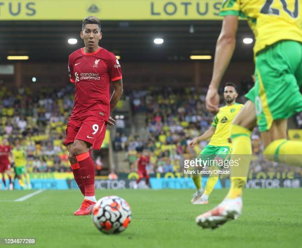 Roberto Firmino of Liverpool puts his hands behind his back to avoid handling a cross during the Premier League match between Norwich City and...