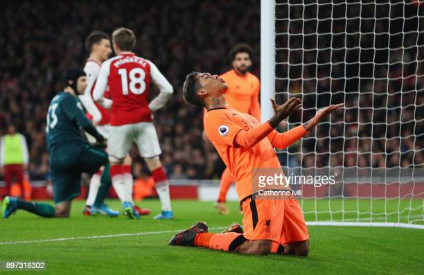 Roberto Firmino of Liverpool reacts after a missed chance during the Premier League match between Arsenal and Liverpool at Emirates Stadium on...