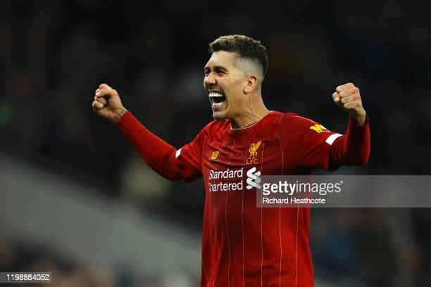 Roberto Firmino of Liverpool reacts after his sides victory during the Premier League match between Tottenham Hotspur and Liverpool FC at Tottenham...