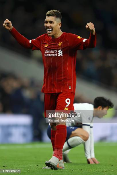 Roberto Firmino of Liverpool reacts after his sides victory the Premier League match between Tottenham Hotspur and Liverpool FC at Tottenham Hotspur...