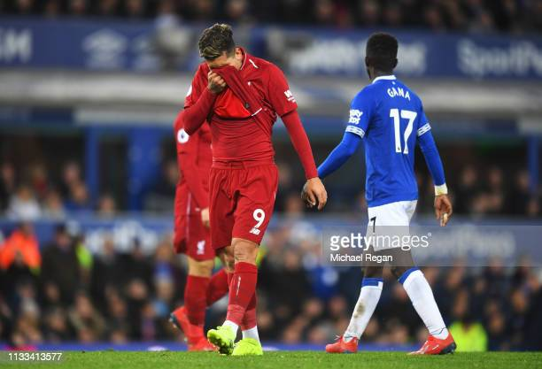 Roberto Firmino of Liverpool reacts during the Premier League match between Everton FC and Liverpool FC at Goodison Park on March 03, 2019 in...