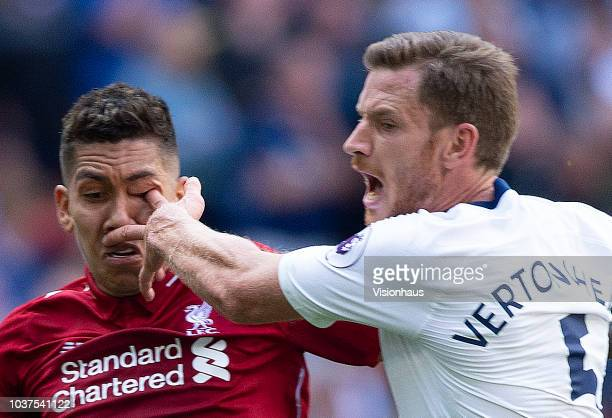 Roberto Firmino of Liverpool receives a finger in the eye from Jan Vertonghen of Tottenham Hotspur during the Premier League match between Tottenham...