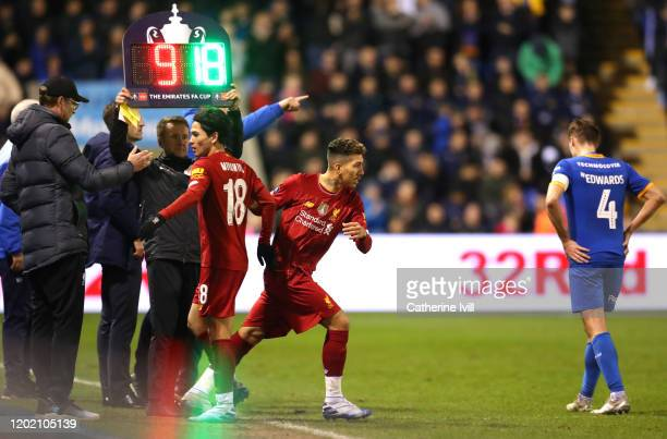 Roberto Firmino of Liverpool replaces Takumi Minamino of Liverpool during the FA Cup Fourth Round match between Shrewsbury Town and Liverpool at New...