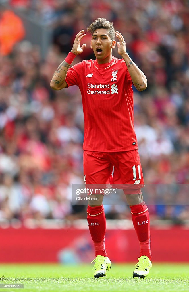 Roberto Firmino of Liverpool rues a missed opportunity during the Barclays Premier League match between Liverpool and West Ham United at Anfield on August 29, 2015 in Liverpool, United Kingdom.