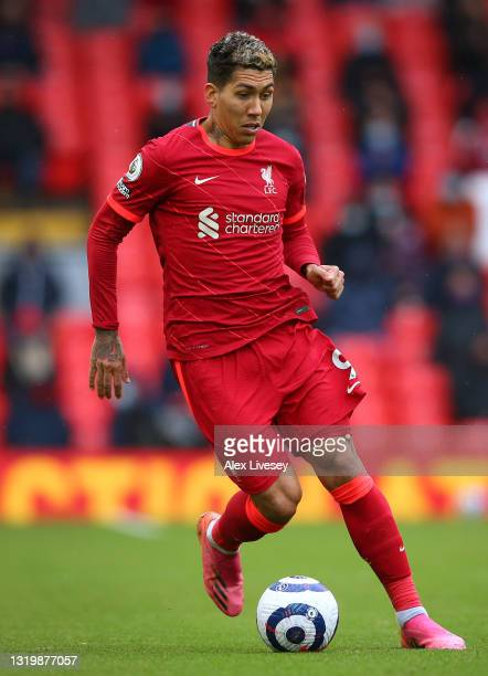 Roberto Firmino of Liverpool runs with the ball during the Premier League match between Liverpool and Crystal Palace at Anfield on May 23, 2021 in...