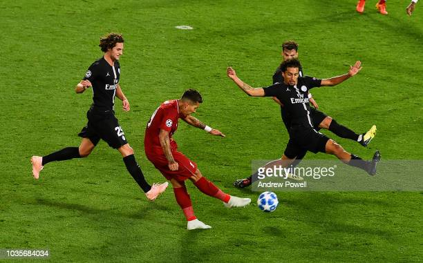 Roberto Firmino of Liverpool scores a goal during the Group C match of the UEFA Champions League between Liverpool and Paris SaintGermain at Anfield...