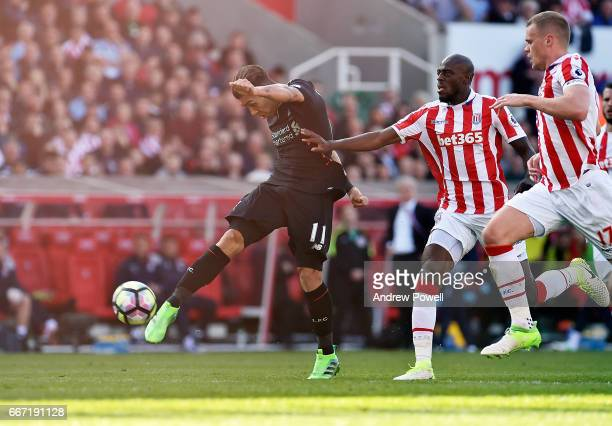 Roberto Firmino of Liverpool scores a goal during the Premier League match between Stoke City and Liverpool at Bet365 Stadium on April 8 2017 in...
