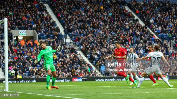 Roberto Firmino of Liverpool scores a goal to make it 01 during the Premier League match between West Bromwich Albion and Liverpool at The Hawthorns...