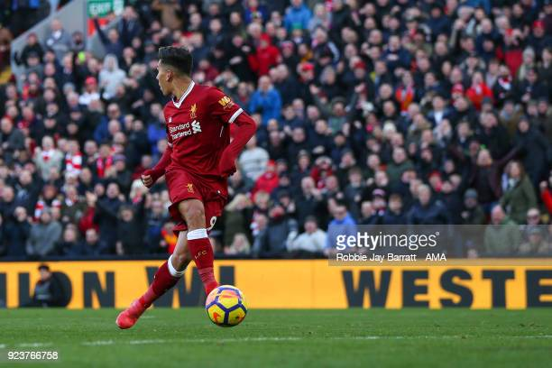 Roberto Firmino of Liverpool scores a goal to make it 31 during the Premier League match between Liverpool and West Ham United at Anfield on February...