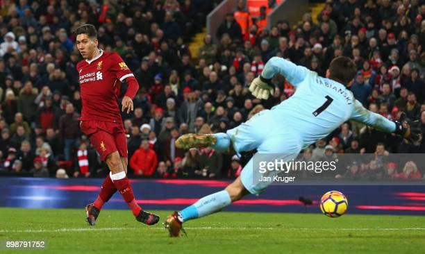 Roberto Firmino of Liverpool scores his second and his sides fourth goal during the Premier League match between Liverpool and Swansea City at...