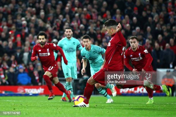 Roberto Firmino of Liverpool scores his sides fifth goal during the Premier League match between Liverpool FC and Arsenal FC at Anfield on December...