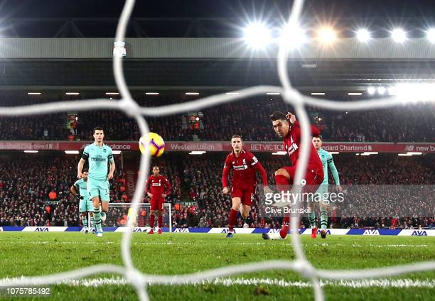 Roberto Firmino of Liverpool scores his sides fifth goal from the penalty spot during the Premier League match between Liverpool FC and Arsenal FC at...