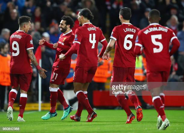 Roberto Firmino of Liverpool scores his sides fifth goal with team mate Mohamed Salah of Liverpool during the UEFA Champions League Semi Final First...